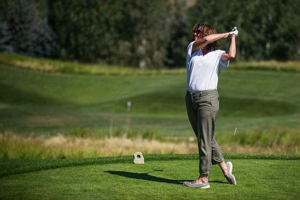 Singer Amy Grant tees off at hole 7 at the Snowmass Club for the Challenge Aspen benefit known as the Vince Gill and Amy Grant 14th Anniversary Gala and Golf Classic on Tuesday.
