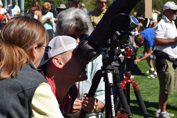 Viewing the solar eclipse through a telescope was the preferred method for many who flocked to the Galena Plaza to take in the eclipse party staged by Aspen Science Center and Pitkin County Library.