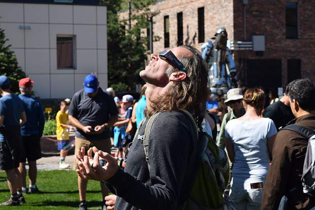 Aspen resident Monte Love revels in Monday's ecliptic event put on by Aspen Science Center and Pitkin County Library in the Galena Plaza.