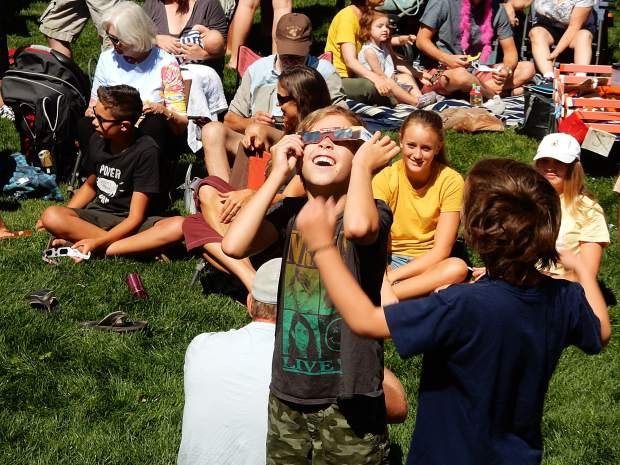 Spectators took turns using special glasses to view the Great American Eclipse on Monday at Basalt Regional Library.