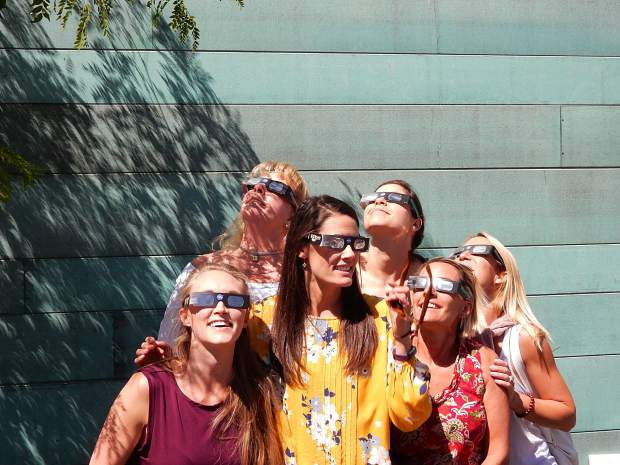Glasses and smiles were a common sight Monday as a crowd gathered at Basalt Regional Library to view the Great American Eclipse.
