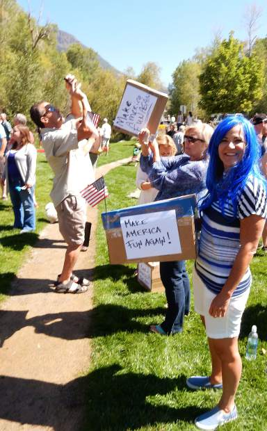 These ladies added to the party atmosphere in the lawn of Basalt Regional Library with eclipse viewing boxes with signs that said,