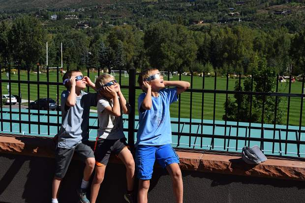 A group of youngsters from Marble view Monday's solar eclipse from Galena Plaza.