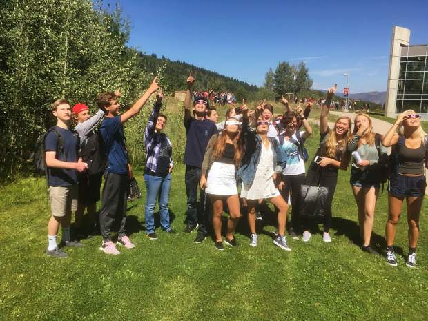 Armed with special glasses and some curiosity, Aspen High School students started off the year Monday by taking in the solar eclipse.