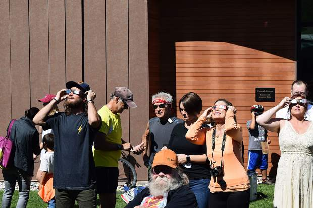 Eclipse glasses were in high demand Monday at Galena Plaza, where the Aspen Science Center and Pitkin County Library hosted a viewing party that attracted hundreds of gatherers. The Science Center distributed more than 1,000 pairs of special viewing glasses, said David Houggy, the nonprofit's executive director.