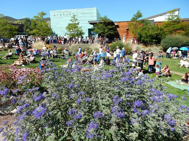 Spectators started collecting on the lawn of the Basalt Regional Library at 9:30 a.m. Monday for the Great American Eclipse event. Hundreds had gathered by prime time.