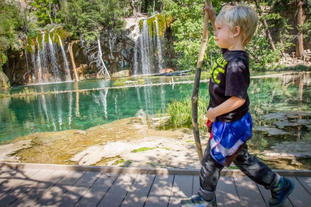 Five-year-old Ethan Patterson walks along the boardwalk after making the trek up to Hanging Lake on Tuesday morning.