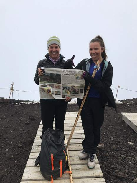 Aspen resident Nancy Reiland Domingue and daughter Ainsley Domingue display The Aspen Times at the summit of Japan's Mt. Fuji, the country's largest peak at 3,776 meters, or 12,389 feet.