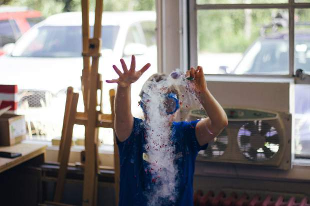 Aspen Science Center education coordinator Maya Hunt demonstrated super-cold temperatures by freezing a rose in liquid nitrogen at the annual Summer Science Fair on Aug. 6.