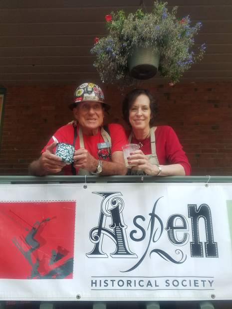 Jay Parker and Laura Mathews enjoy some Aspen Crud in the Wheeler/Stallard House Museum veranda after dishing out cold treats at the Aspen Historical Society's Annual Ice Cream Social on Aug. 5. Parker serves on the society's board of trustees and Mathews is an archives volunteer for the nonprofit.