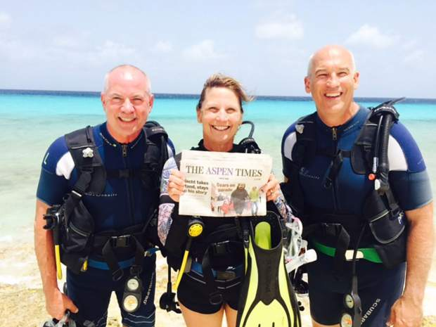Scuba divers Pete and Debby Hayda of Aspen, with Brad Wyatt of Glenwood Springs, show off a copy of The Aspen Times before heading into the water on the Dutch island of Bonaire.