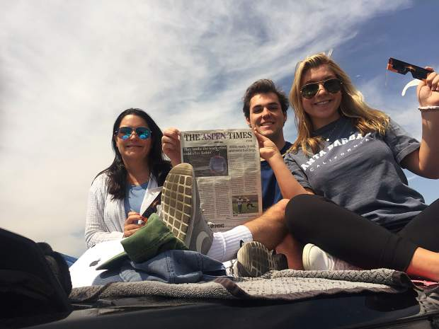 Mary Virginia, Cooper and Mary Tarver Reid display an Aspen Times while in Casper, Wyoming, immediately after Monday's eclipse. Email your