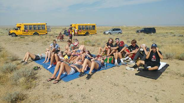 Aspen High School's IB physics students made the trip to Wyoming to spread out on the ground and watch Monday's solar eclipse.