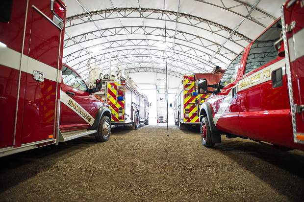 Trucks are double parked at the temporary Snowmass fire department area.
