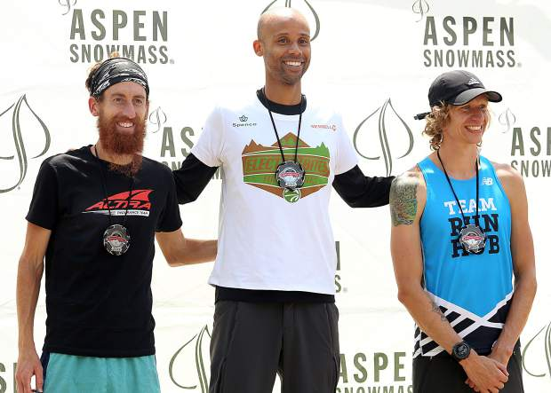 Colorado Springs' Joseph Gray, center, stands atop the podium after winning Saturday's Vertical K race up Aspen Mountain, part of the Audi Power of Four Race Series. Arizona's Mike Popejoy, left, and Oregon's Devin Vanscoy took second and third, respectively.