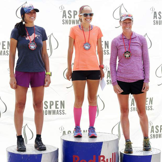 Littleton's Kristin Renshaw, center, stands atop the podium after winning Saturday's women's Vertical K race up Aspen Mountain, part of the Audi Power of Four Race Series. Boulder's Jackie Harlow, left, and South Carolina's Sarah Hansel took second and third, respectively.
