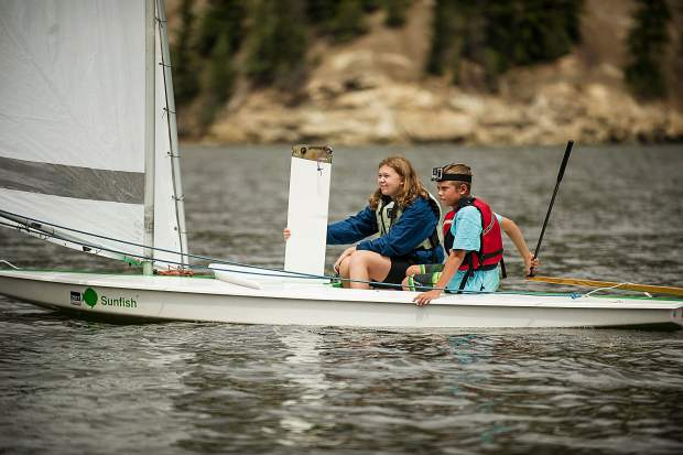 Frenna White, 14, and Henry Hendrix, 10, sailing in the races held on Ruedi Reservoir on Tuesday.