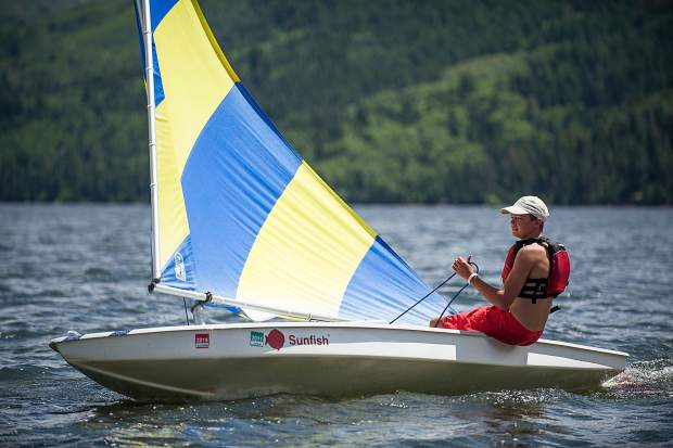 Sean Connolly, a coach for the Don Sheeley Sailing School, practices sailing during the races on Ruedi Reservoir on Tuesday.