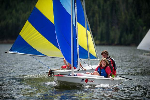 Isla White, 10, and Spencer Perley, 14, sailing on Ruedi Reservoir on Tuesday.