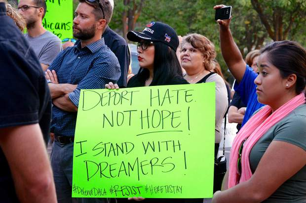 Protesters rallied outside Glenwood's Colorado Mountain College building Tuesday evening after news came earlier in the day that the Deferred Action for Childhood Arrivals program was being rescinded.