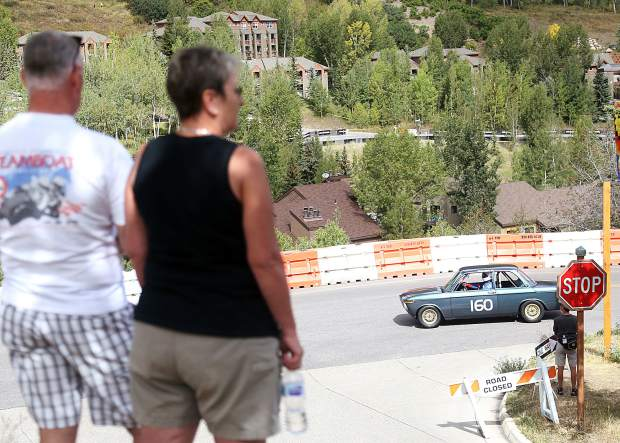 A car cruises around the track as spectators watch Thursday for the Rocky Mountain Vintage Racing Aspen Snowmass Vintage Car Race in Snowmass Village. This was the inaugural year for the Snowmass Street Race.