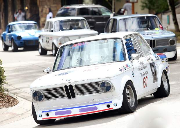 A 1970s era BMW leads a group of cars onto the track Thursday for the Rocky Mountain Vintage Racing Aspen Snowmass Vintage Car Race in Snowmass Village. This was the inaugural year for the Snowmass Street Race.