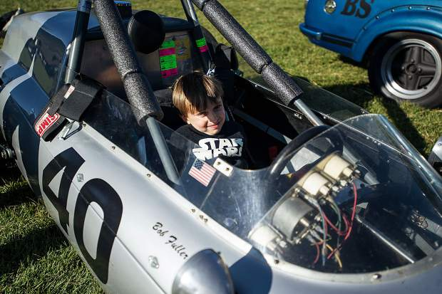 Benjamin Gardner, 4, makes himself at home in one of the race cars at the vintage car collection show.