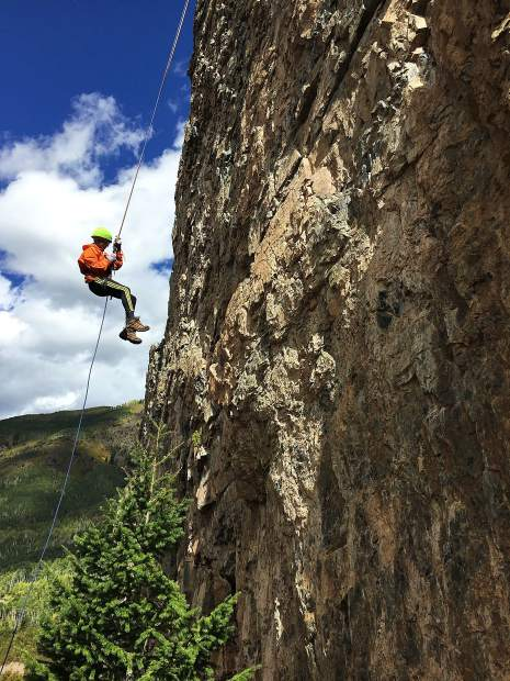 An eighth-grader in last year's Outdoor Education program completes the high repel at Marble base camp.