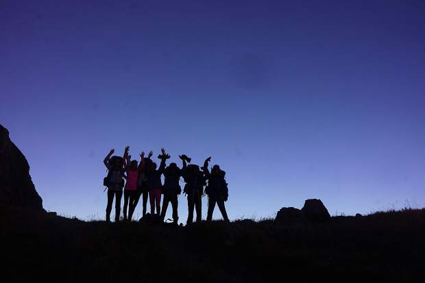 A group of Aspen eight-graders celebrates a successful day on the trail during the 2016 Outdoor Education program.