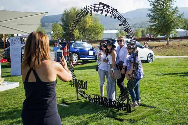 A group poses in the hashtag sculpture JAS Aspen Snowmass Labor Day Experience on Saturday.