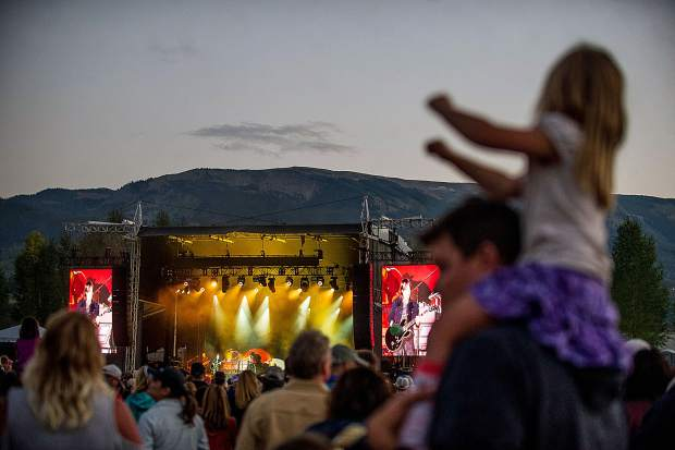 A little girl dancing during Keith Urban's performance at the JAS Aspen Snowmass Labor Day Experience on Saturday night.