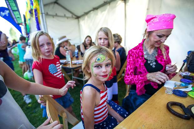 Marley Cramer, 8, getting her face painted on Saturday in Snowmass for the JAS Aspen Snowmass concerts.