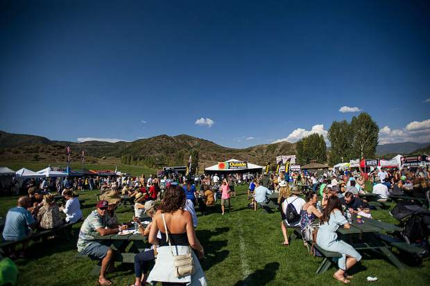 The food and drink area with the Outside Magazine stage on Saturday in Snowmass at JAS Aspen Snowmass Labor Day Experience.