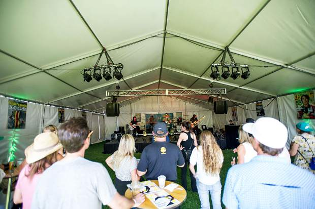 A band performing in the Outside Magazine tent Saturday afternoon in Snowmass during the JAS Aspen Snowmass Labor Day Experience.