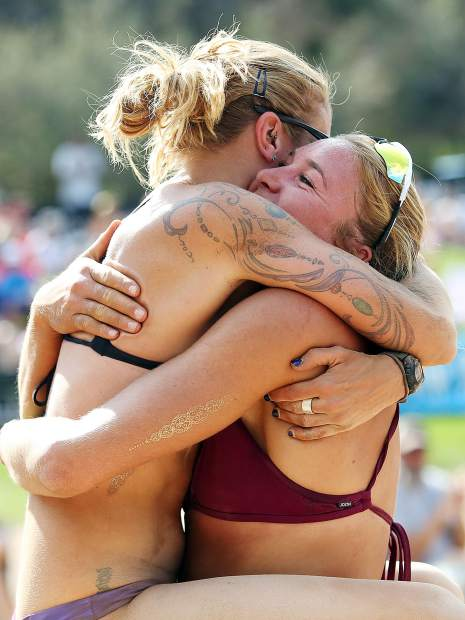 Liz Card, left, hugs teammate Cassie House after the duo won the women's open title Monday at the 45th annual MotherLode Volleyball Classic at Koch Lumber Park in Aspen.
