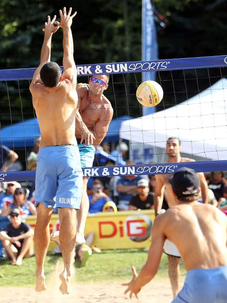 Utah's Daniel Dalanhese, back left, sends a shot over the net in the men's open final Monday at the 45th annual MotherLode Volleyball Classic at Koch Lumber Park in Aspen.