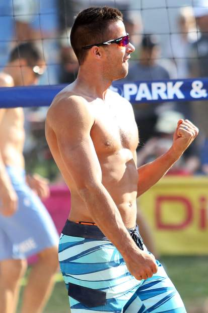 Utah's Daniel Dalanhese celebrates a crucial point in the men's open final Monday at the 45th annual MotherLode Volleyball Classic at Koch Lumber Park in Aspen.