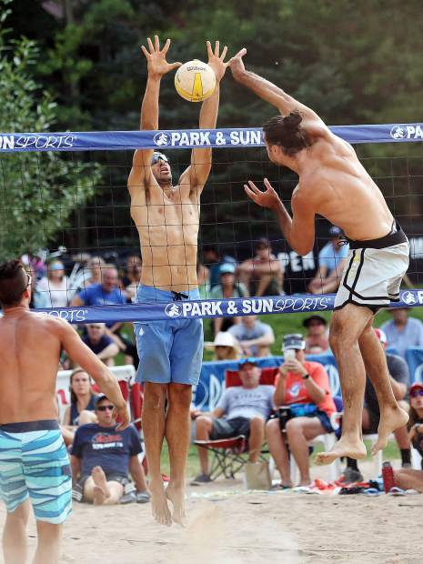 Utah's Duncan Budinger, right, tries to get a shot past Wisconsin native Bill Kolinske in the men's open final Monday at the 45th annual MotherLode Volleyball Classic at Koch Lumber Park in Aspen.