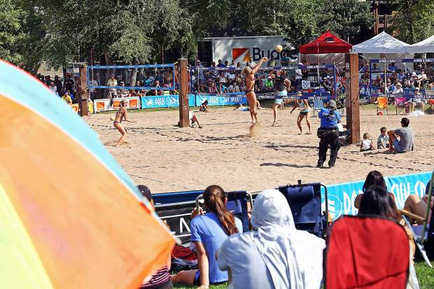Fans watch the women's open final Monday at the 45th annual MotherLode Volleyball Classic at Koch Lumber Park in Aspen.