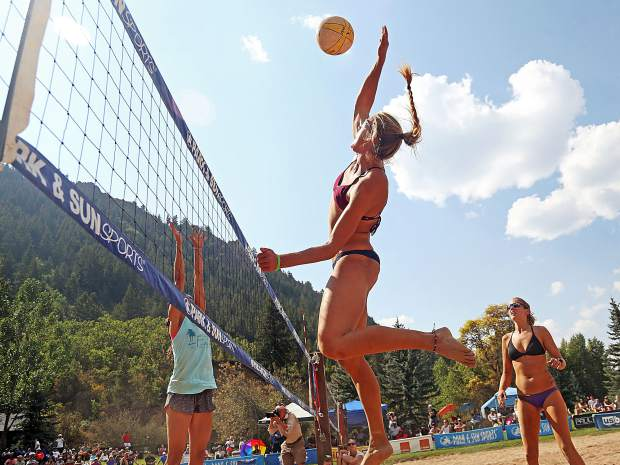 New Mexico's Cassie House goes vertical for a hit while playing in the women's open finals Monday at the 45th annual MotherLode Volleyball Classic at Koch Lumber Park in Aspen. House and Denver's Liz Card won the women's title.