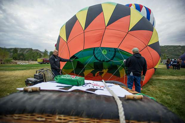 Crews help inflate a hot air balloon at the Snowmass 42nd Annual Balloon Festival on Friday morning.