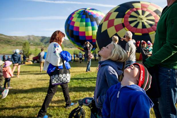 Alden, 5, and Heidi Hancock, 7, enjoy the Snowmass Balloon Festival on Saturday morning.