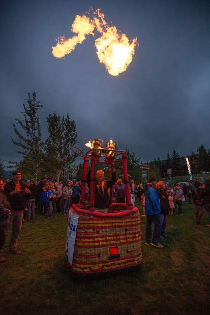 One of the pilots launching fire from his hot air balloon basket Saturday evening in Snowmass since the GLOW show was cancelled due to weather.