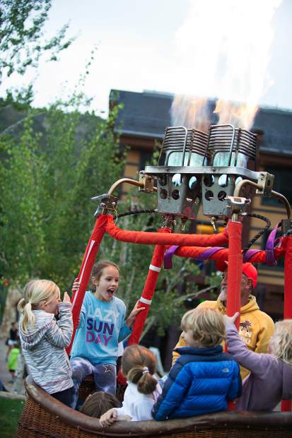 Pilot Kenny Bradley launches fire and has a basket full of kids Saturday night in Snowmass when the GLOW show was cancelled due to weather.