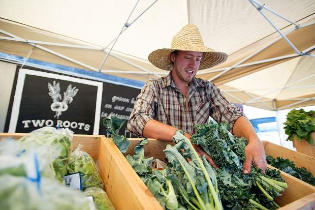 Christian La Bar of Two Roots Farm sells produce at the Aspen Farmer's Market.