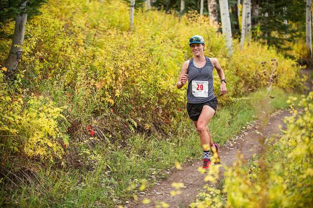 Madeline McKeever running in the Golden Leaf half marathon approaching milemarker 4 on the Government Trail in Snowmass on Saturday. McKeever took first for women overall with a time of 01:35:36.1.