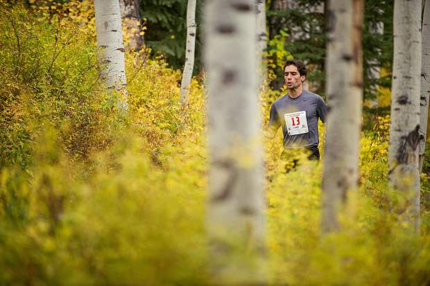 Robert Torphy approaching milemarker 4 in the Golden Leaf half marathon on Saturday in Snowmass.