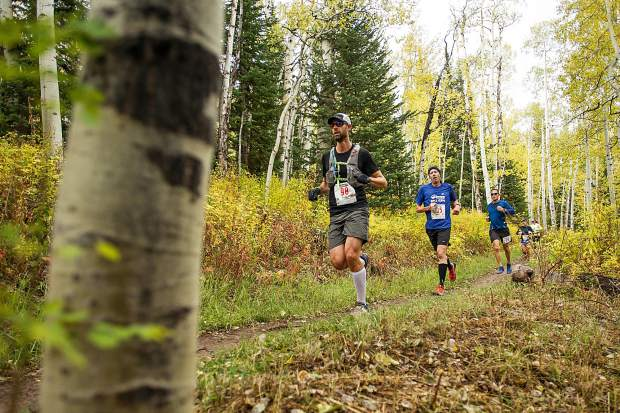 Runners approaching milemarker 4 on the Government Trail in the Golden Leaf half marathon on Saturday in Snowmass.