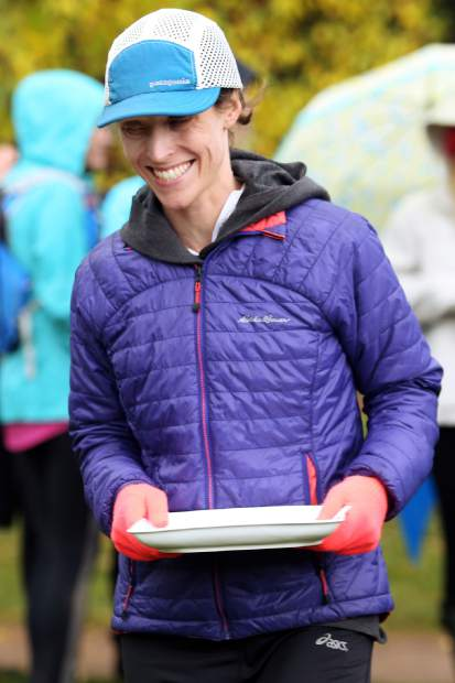 Englewood's Madeline McKeever receives her prize for being the top female finisher in Saturday's Golden Leaf Half Marathon trail race from Snowmass Village to Aspen.