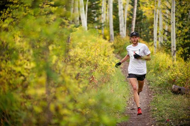 Ryan Phebus runs in the Golden Leaf half marathon approaching milemarker 4 on the Government Trail in Snowmass on Saturday. Phebus took first for men overall with a time of 01:25:51.9.